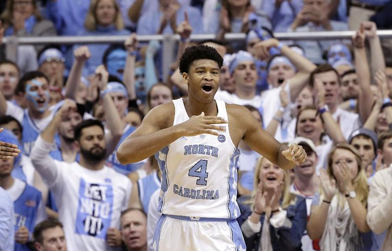 North Carolina's Isaiah Hicks (4) reacts following a basket against Duke during the second half of an NCAA college basketball game in Chapel Hill, N.C., Saturday, March 4, 2017. (AP Photo/Gerry Broome)