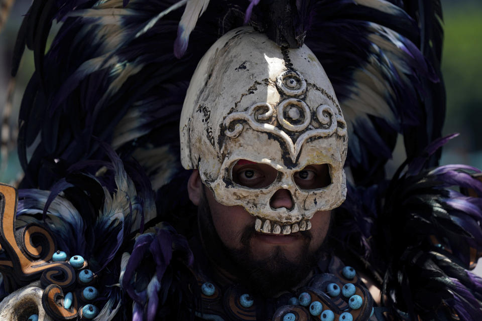 A dancer joins a performance as part of the commemoration marking the 700 year anniversary of the founding of the Aztec city of Tenochtitlan, known today as Mexico City, at the Zocalo square in Mexico City, Monday, July 26, 2021, amid the new coronavirus pandemic. (AP Photo/Fernando Llano)