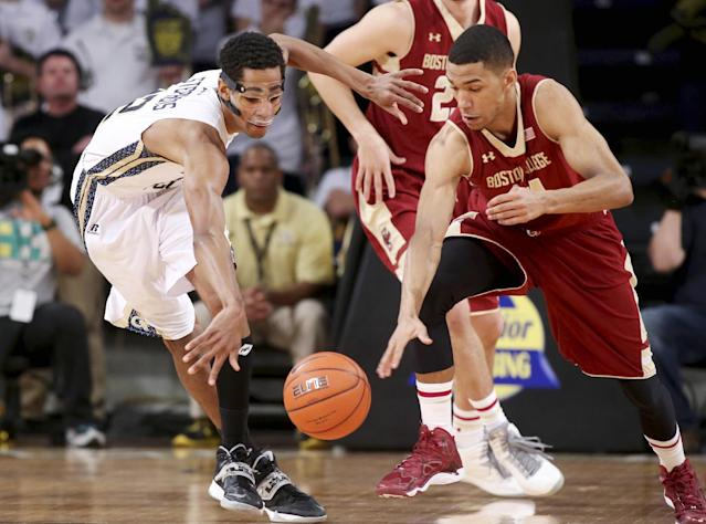 Boston College guard Olivier Hanlan, right, steals the ball away from Georgia Tech forward Quinton Stephens in the first half of an NCAA college basketball game Thursday, Feb. 13, 2014, in Atlanta. (AP Photo/Jason Getz)