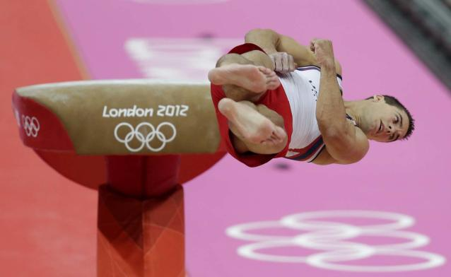 U.S. gymnast Jacob Dalton performs on the vault during the Artistic Gymnastic men's team final at the 2012 Summer Olympics, Monday, July 30, 2012, in London. (AP Photo/Gregory Bull)