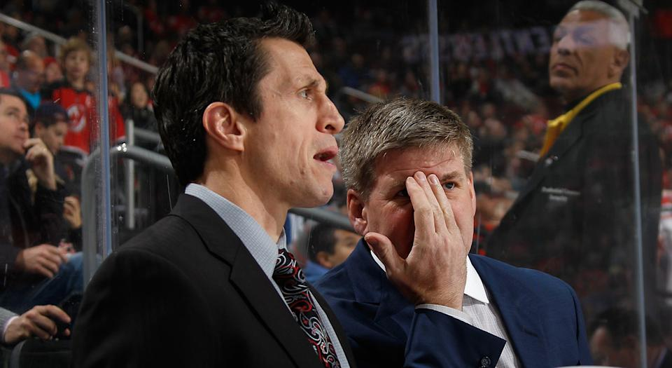 NEWARK, NJ - MARCH 01: Head coach Bill Peters of the Carolina Hurricanes speaks with assistant coach Rob Brind'Amour during the first period against the New Jersey Devils at the Prudential Center on March 1, 2016 in Newark, New Jersey.  (Photo by Bruce Bennett/Getty Images)