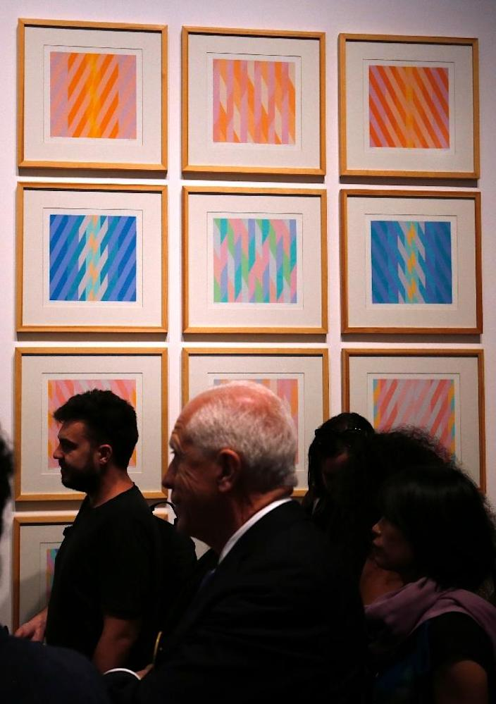 """Artworks at the """"Jerusalem Lives"""" exhibition at the Palestinian Museum on August 26, 2017 (AFP Photo/ABBAS MOMANI)"""