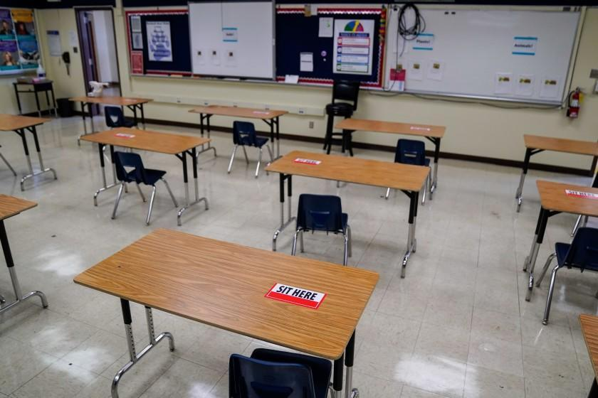 "Labels on desks designate where students can sit with respect to social distancing at a Los Angeles Unified School District campus. <span class=""copyright"">(Kent Nishimura / Los Angeles Times)</span>"