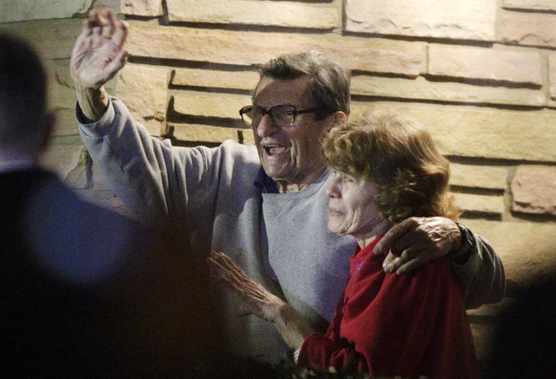 FILE - In this Nov. 9, 2011 file photo, former Penn State Coach Joe Paterno and his wife, Sue Paterno, stand on their porch to thank supporters gathered outside their home in State College, Pa. Joe Paterno earned a state pension of $13.4 million for his 61-year coaching career at Penn State. Paterno's family announced Tuesday, May 22, 2012, through a spokesman that Paterno's widow, Sue, would receive an initial payment of $10.1 million by the end of May, with the rest to be paid out over the next two years. (AP Photo/Gene J. Puskar, File)