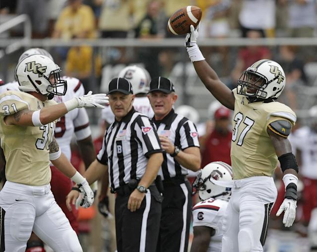 Central Florida defensive back Brandon Alexander (37) celebrates after recovering a fumble by South Carolina quarterback Connor Shaw during the first half of an NCAA college football game in Orlando, Fla., Saturday, Sept. 28, 2013. Shaw was injured on the play and left the game.(AP Photo/John Raoux)