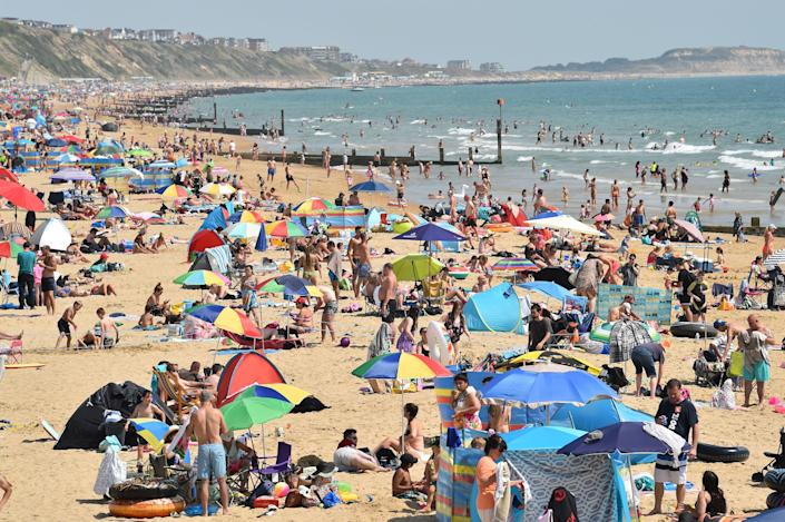 Beachgoers enjoy the sunshine on Bournemouth beach on Friday (Picture: Getty)