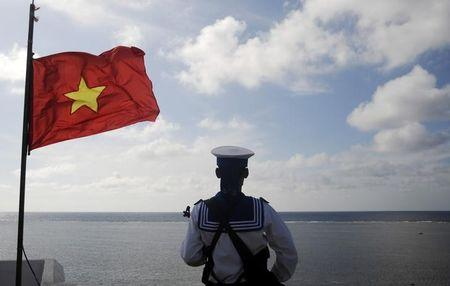 A Vietnamese naval soldier stands quard at Thuyen Chai island in the Spratly archipelago