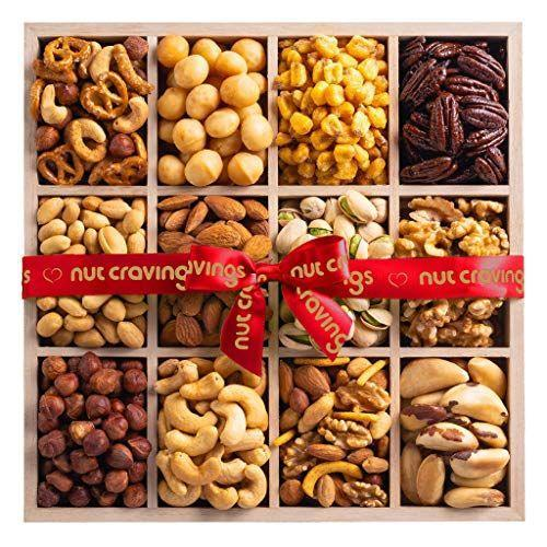 "<p><strong>Nut Cravings</strong></p><p>amazon.com</p><p><strong>$35.95</strong></p><p><a href=""https://www.amazon.com/dp/B083X757ZX?tag=syn-yahoo-20&ascsubtag=%5Bartid%7C2139.g.36153513%5Bsrc%7Cyahoo-us"" rel=""nofollow noopener"" target=""_blank"" data-ylk=""slk:BUY IT HERE"" class=""link rapid-noclick-resp"">BUY IT HERE</a></p><p>When you can't figure out what type of Father's Day gift would be best, you can't go wrong with food. If your stepdad is a fan of nuts, this assorted gourmet gift basket is sure to please.</p>"