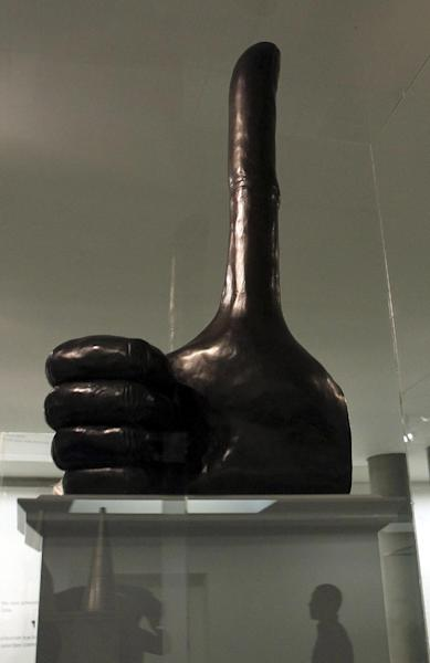 "British artist David Shrigley's 32-foot (10-meter) bronze thumb sculpture which is one of six proposals for the fourth plinth in Trafalgar Square, central London, exhibited in St Martin-in-the-Fields Church, central London, Tuesday Sept. 24, 2013. Six art works are unveiled in miniature Tuesday, two of which will eventually be chosen for display on Trafalgar square's empty ""fourth plinth,"" one of the city's major platforms for public art. (AP Photo/Sean Dempsey, PA) UNITED KINGDOM OUT - NO SALES - NO ARCHIVES"