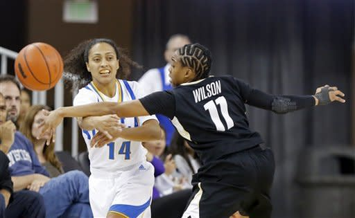 Colorado guard Brittany Wilson (11) defends as UCLA guard Mariah Williams (14) passes in the first half of an NCAA women's college basketball game in Los Angeles Friday, Feb. 1, 2013. (AP Photo/Reed Saxon)