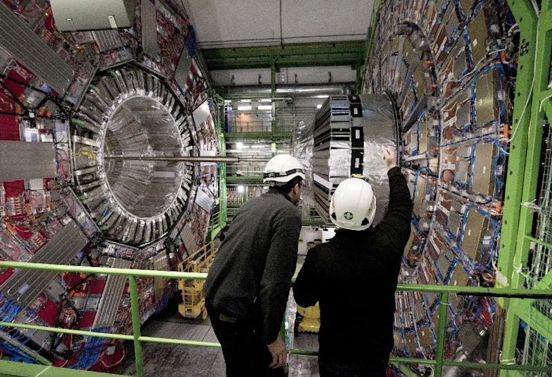 Workers check equipment at CERN in February, 2015 (AFP Photo/Richard Juilliart)