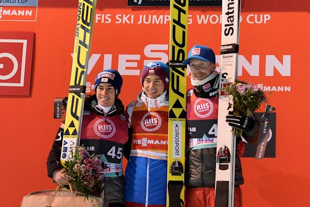 Ski Jumping - FIS World Cup - Men's Large Hill - Granaasen, Trondheim, Norway - March 15, 2018 - Second-placed Stefan Kraft of Austria, winner Kamil Stoch of Poland and third-placed Robert Johansson of Norway on the podium. NTB Scanpix/Ned Alley via REUTERS ATTENTION EDITORS - THIS IMAGE WAS PROVIDED BY A THIRD PARTY. NORWAY OUT. NO COMMERCIAL OR EDITORIAL SALES IN NORWAY.