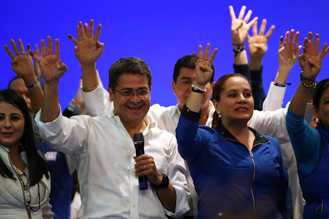 <p>Honduras President and National Party candidate Juan Orlando Hernandez celebrates with supporters and his wife Ana Garcia de Hernandez after the first official presidential election results were released in Tegucigalpa, Honduras, Nov. 27, 2017. (Photo: Edgard Garrido/Reuters) </p>