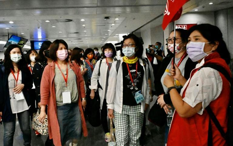 Excited tourists arrived at the airport about five hours before their flight in order to be tested for the coronavirus