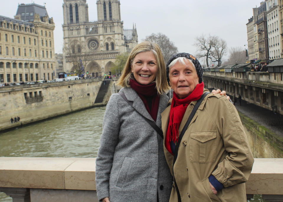 This December 2018 photo shows Lisa Hill, left, and her mother, Pat White, in Paris. Separated due to the coronavirus pandemic, Hill is gifting her mom a virtual cooking lesson for Mother's Day. Isolation due to the coronavirus outbreak has led mothers and offspring to find creative ways to celebrate. (Sara Montgomery via AP)