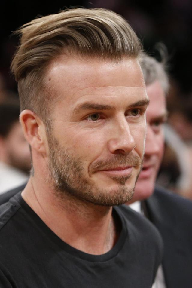 Soccer star David Beckham attends an NBA basketball game between the Miami Heat and the New York Knicks Saturday, Feb. 1, 2014, in New York. Miami won 106-91. (AP Photo/Jason DeCrow)
