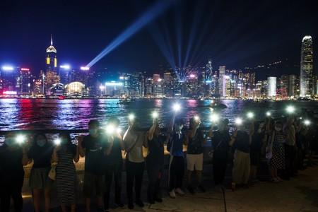 Protesters hold hands to form a human chain at the Avenue of Stars in Hong Kong