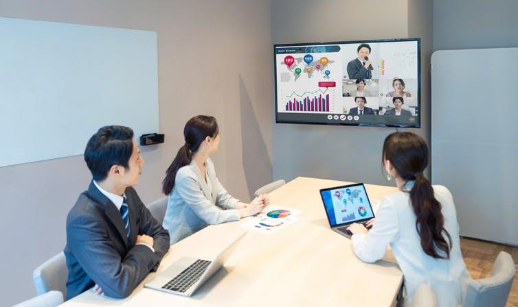 Chinese people having Zoom conference in office