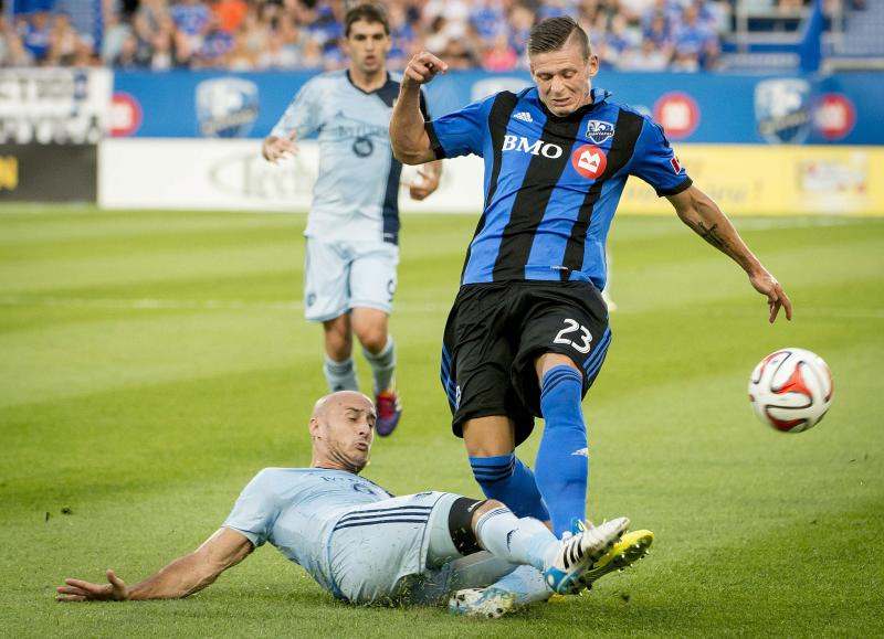 MLS rescinds red card for KC's Collin