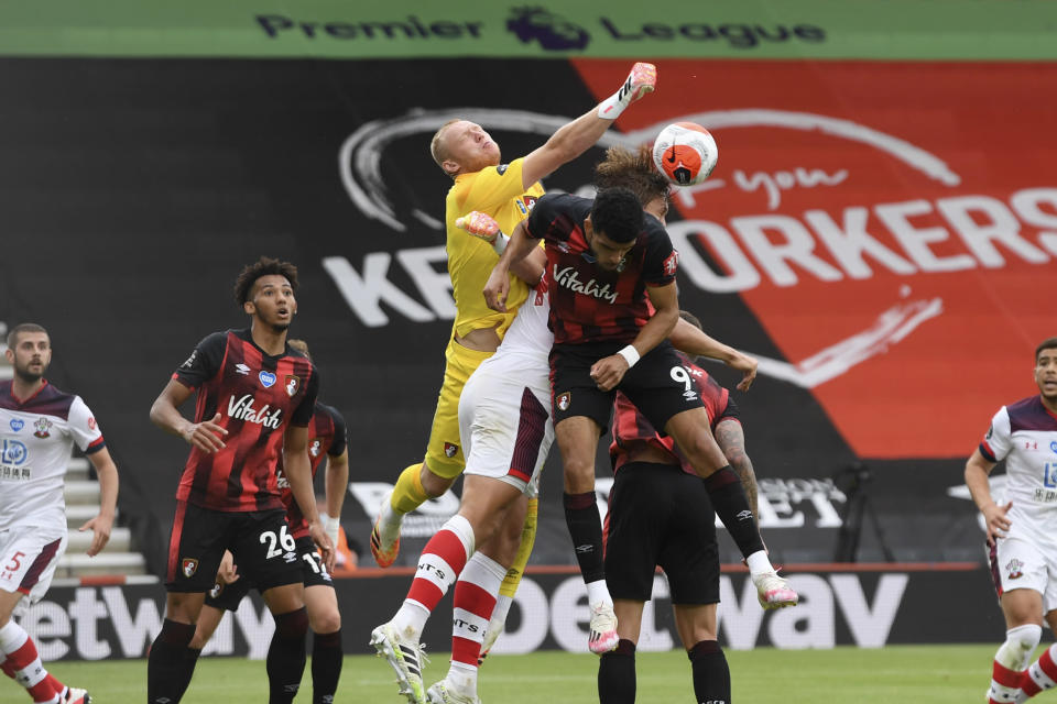 Bournemouth's goalkeeper Aaron Ramsdale punches to clear the ball during the English Premier League soccer match between Bournemouth and Southampton, at the Vitality Stadium in Bournemouth, England, Sunday, July 19, 2020. (Mike Hewitt/Pool Photo via AP)