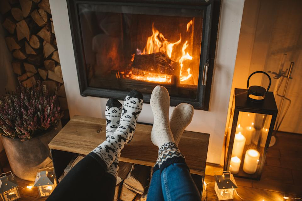 Lazy winer day in front of fire in fireplace.