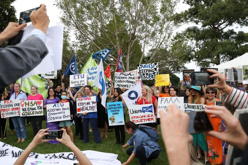 People participate in a rally for International Women's Day in Sydney