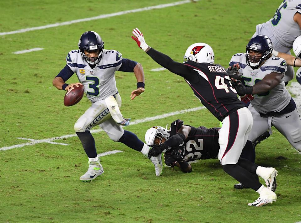 GLENDALE, ARIZONA - OCTOBER 25: Russell Wilson #3 of the Seattle Seahawks runs with the ball against the Arizona Cardinals at State Farm Stadium on October 25, 2020 in Glendale, Arizona. (Photo by Norm Hall/Getty Images)