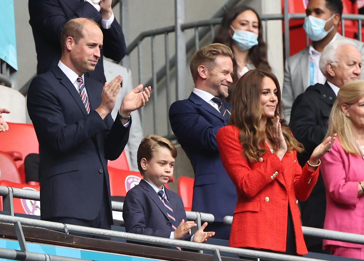 29 June 2021, United Kingdom, London: Football: European Championship, England - Germany, final round, round of 16 at Wembley Stadium. The British Prince William, Duke of Cambridge stands with his wife Kate, Duchess of Cambridge, and their son Prince George in the stands. Photo: Christian Charisius/dpa (Photo by Christian Charisius/picture alliance via Getty Images)