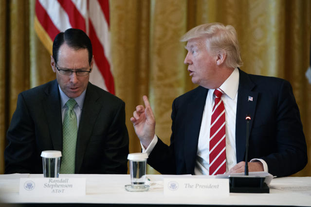 "AT&T CEO Randall Stephenson, left, listens as President Donald Trump speaks during the ""American Leadership in Emerging Technology"" event in the East Room of the White House in Washington. (AP Photo/Evan Vucci, File)"
