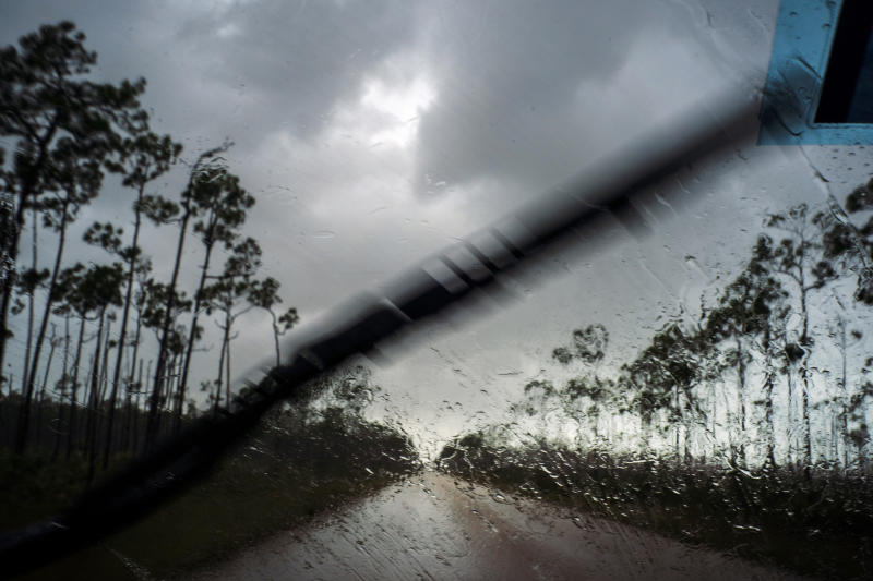 A car returns to the capital under the previous rain before the arrival of Hurricane Dorian in Freeport, Grand Bahama, Bahamas, Sept. 1, 2019. (Photo: Ramon Espinosa/AP)