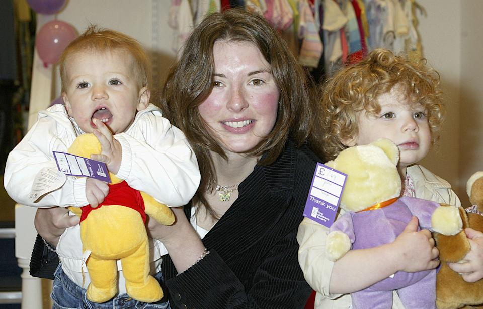 LONDON - MAY 4:  Jools Oliver, wife of Jamie Oliver,  poses with her daughters Daisy and Poppy at the opening of The Children's Society's new flagship store in West Hampstead on May 4, 2004 in London.  (Photo by Jo Hale/Getty Images)