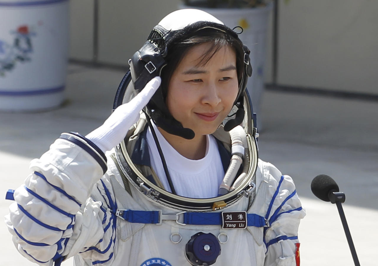 China's first female astronaut Liu Yang salutes during a sending off ceremony as she departs for the Shenzhou 9 spacecraft rocket launch pad at the Jiuquan Satellite Launch Center in Jiuquan, China, Saturday, June 16, 2012. China will send its first woman and two other astronauts into space Saturday to work on a temporary space station for about a week, in a key step toward becoming only the third nation to set up a permanent base in orbit.(AP Photo/Ng Han Guan)
