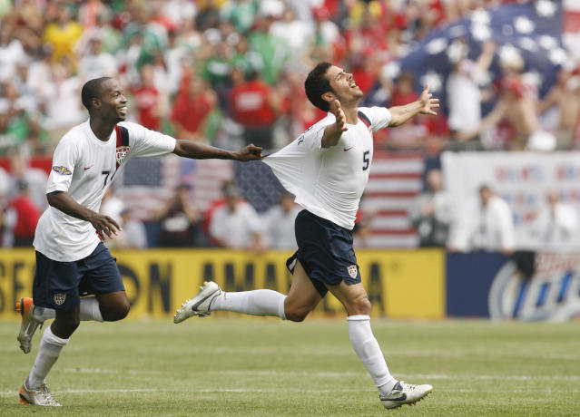 FILE - In this June 24, 2007, file photo, USA's Benny Feilhaber, right, celebrates with DaMarcus Beasley after scoring the winning goal against Mexico during the second half of the Gold Cup soccer final in Chicago. Midfielder Benny Feilhaber retired from soccer on Wednesday, March 11, 2020, after a career that included playing for the United States at the 2010 World Cup and nine years in Major League Soccer. (AP Photo/Nam Y. Huh, File)