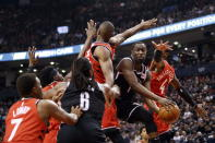 Brooklyn Nets guard Theo Pinson (1) looks to pass as he drives to the hoop against the Toronto Raptors during the first half of an NBA basketball game in Toronto, Saturday, Dec. 14, 2019. (Cole Burston/The Canadian Press via AP)