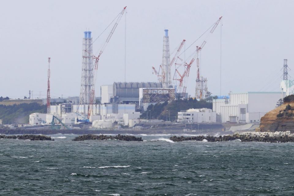 Fukushima Daiichi nuclear power plant is seen from Namie town, Fukushima prefecture, north of Tokyo, Tuesday, April 13, 2021, Japan's government said Tuesday it has decided to start releasing massive amounts of radioactive water stored in tanks at the wrecked Fukushima nuclear plant in two years after treatment. (Yusuke Ogata/Kyodo News via AP)