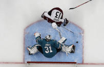 San Jose Sharks goaltender Martin Jones (31) defends a shot by Colorado Avalanche center Alexander Kerfoot (13) during the third period of Game 7 of an NHL hockey second-round playoff series in San Jose, Calif., Wednesday, May 8, 2019. (AP Photo/Jeff Chiu)