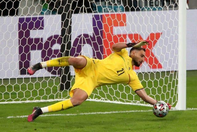 Gianluigi Donnarumma saves from Alvaro Morata, not pictured, during the semi-final shootout against Spain