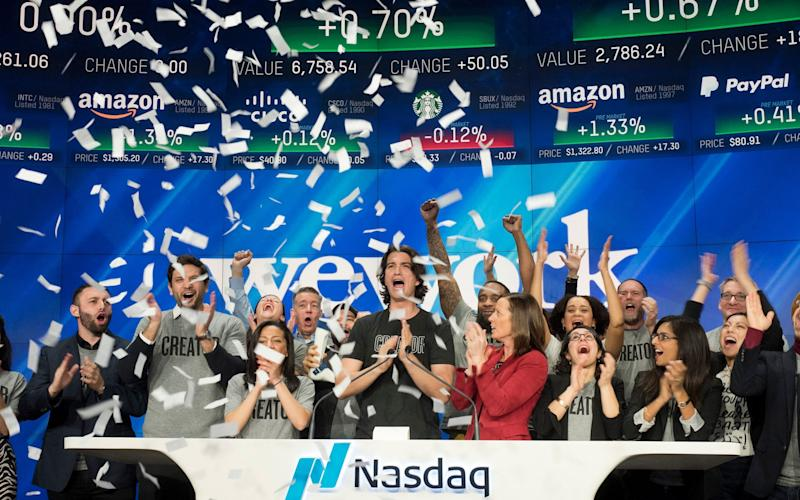 WeWork in happier times, attending the opening ceremony of the Nasdaq stock exchange in New York City, 2018 - AP