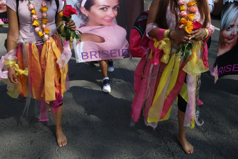 Women walk barefoot on asphalt, clothed in shreds of organza in pastel shades of pink and yellow, the favorite colors of murder victim Briseida Carreno, during a ceremony in her honor, in Ecatepec, a suburb of Mexico City, Saturday, Nov. 23, 2019. Mexico City's mayor issued a gender alert this week for the capital, meaning that 20 of Mexico's 31 federal entities have declared emergencies over the issue. Activists want more action, and are planning demonstrations to mark Monday's International Day for the Elimination of Violence against Women. (AP Photo/Alicia Fernandez)