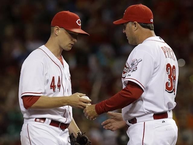 Cincinnati Reds manager Bryan Price takes out starting pitcher Mike Leake (44) in the eighth inning of a baseball game against the Arizona Diamondbacks, Tuesday, July 29, 2014, in Cincinnati. Leake was the winning pitcher in the game won by Cincinnati 3-0. (AP Photo/Al Behrman)