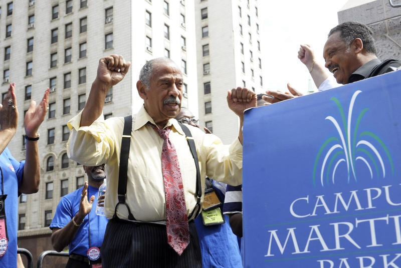 FILE - In an Aug. 24, 2010 file photo, Congressman John Conyers, left, greets the Rev. Jesse Jackson, right, as postal workers rally to save Saturday mail service at the Campus Martius Park, in Detroit. Detroit police say the former congressman died at his home on Sunday, Oct. 27, 2019. He was 90.(Clarence Tabb, Jr./Detroit News via AP, File)
