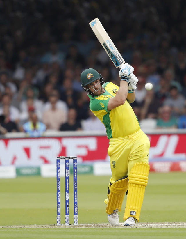 Australia's captain Aaron Finch hits runs off the bowling of England's Mark Wood during their Cricket World Cup match between England and Australia at Lord's cricket ground in London, Tuesday, June 25, 2019. (AP Photo/Alastair Grant)