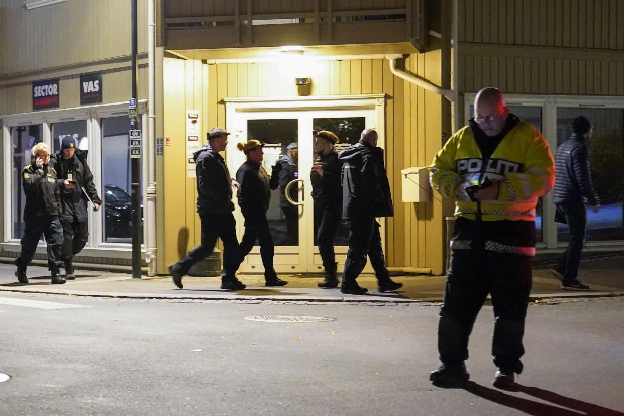 Police work at the scene where an arrow was shot into a wall in Kongsberg, Norway, Wednesday, Oct. 13, 2021. A man armed with a bow and arrows killed several people Wednesday near the Norwegian capital of Oslo before he was arrested, authorities said. (Torstein Bøe/NTB via AP)