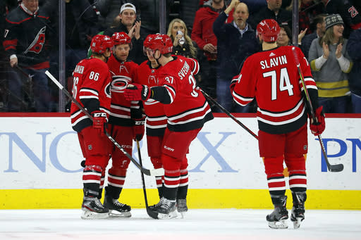Carolina Hurricanes' Justin Williams (14) second left, is congratulated on his goal against the Winnipeg Jets by teammates Teuvo Teravainen (86), of Finland, Sebastian Aho (20), of Finland, Andrei Svechnikov (37), of Russia, and Jaccob Slavin (74) during the first period of an NHL hockey game in Raleigh, N.C., Tuesday, Jan. 21, 2020. (AP Photo/Karl B DeBlaker)