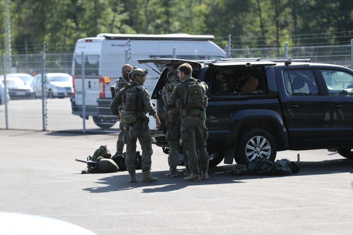 A large police operation is underway outside Hallby Prison near Eskilstuna, Sweden, on Wednesday July 21, 2021. Two inmates are reported to have taken staff members hostage inside the prison. (Per Karlsson / TT via AP)