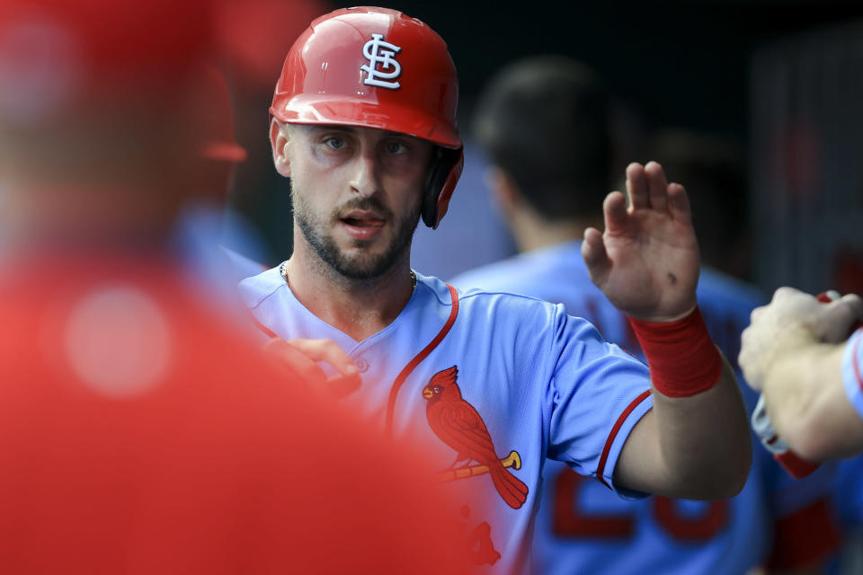 St. Louis Cardinals' Paul DeJong high-fives teammates after scoring during the second inning of the team's baseball game against the Cincinnati Reds in Cincinnati, Saturday, July 24, 2021. (AP Photo/Aaron Doster)