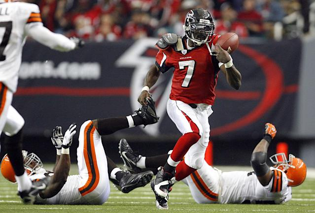 Michael Vick, pictured in 2006 as an Atlanta Falcon, was a force in the league. (Photo by Kevin C. Cox/Getty Images)