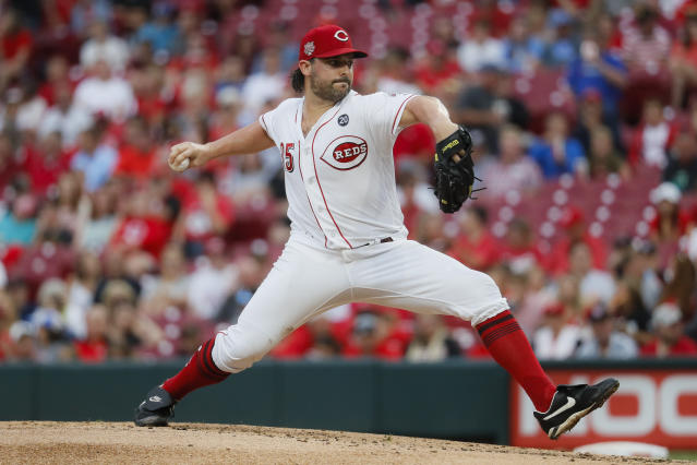 Cincinnati Reds starting pitcher Tanner Roark throws in the second inning of a baseball game against the Pittsburgh Pirates, Tuesday, July 30, 2019, in Cincinnati. (AP Photo/John Minchillo)
