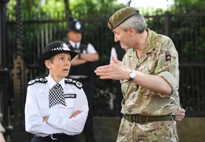Head of the Met Police Cressida Dick speaking with a soldier. (PA)