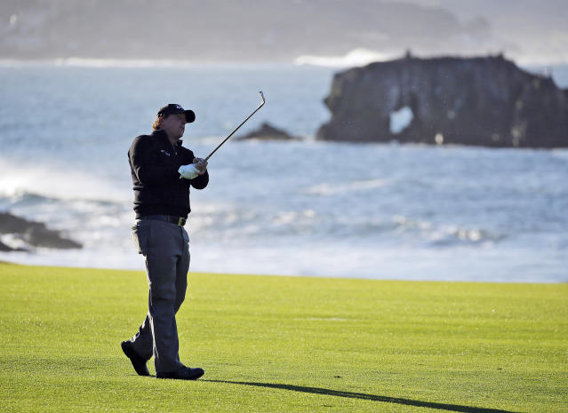 FILE - In this Feb. 11, 2019, file photo, Phil Mickelson hits from the 18th fairway of the Pebble Beach Golf Links during the final round of the AT&T Pebble Beach Pro-Am golf tournament in Pebble Beach, Calif. At Pebble Beach, a course teeming with history for Mickelson, the 48-year-old, five-time major champion will come face to face with what might be his last, best chance to win the U.S. Open and become the sixth player to complete the career Grand Slam. (AP Photo/Eric Risberg, File)